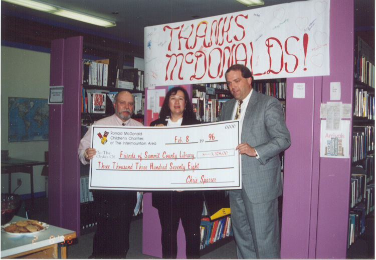 1996 Feb 8 Mark Young of McDonald's Restaurant awards grant check for Summit County Library
