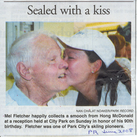 2008 June 18- Mel Fletcher happily collects smooch from Hong McDonald at his 90th birthday party.