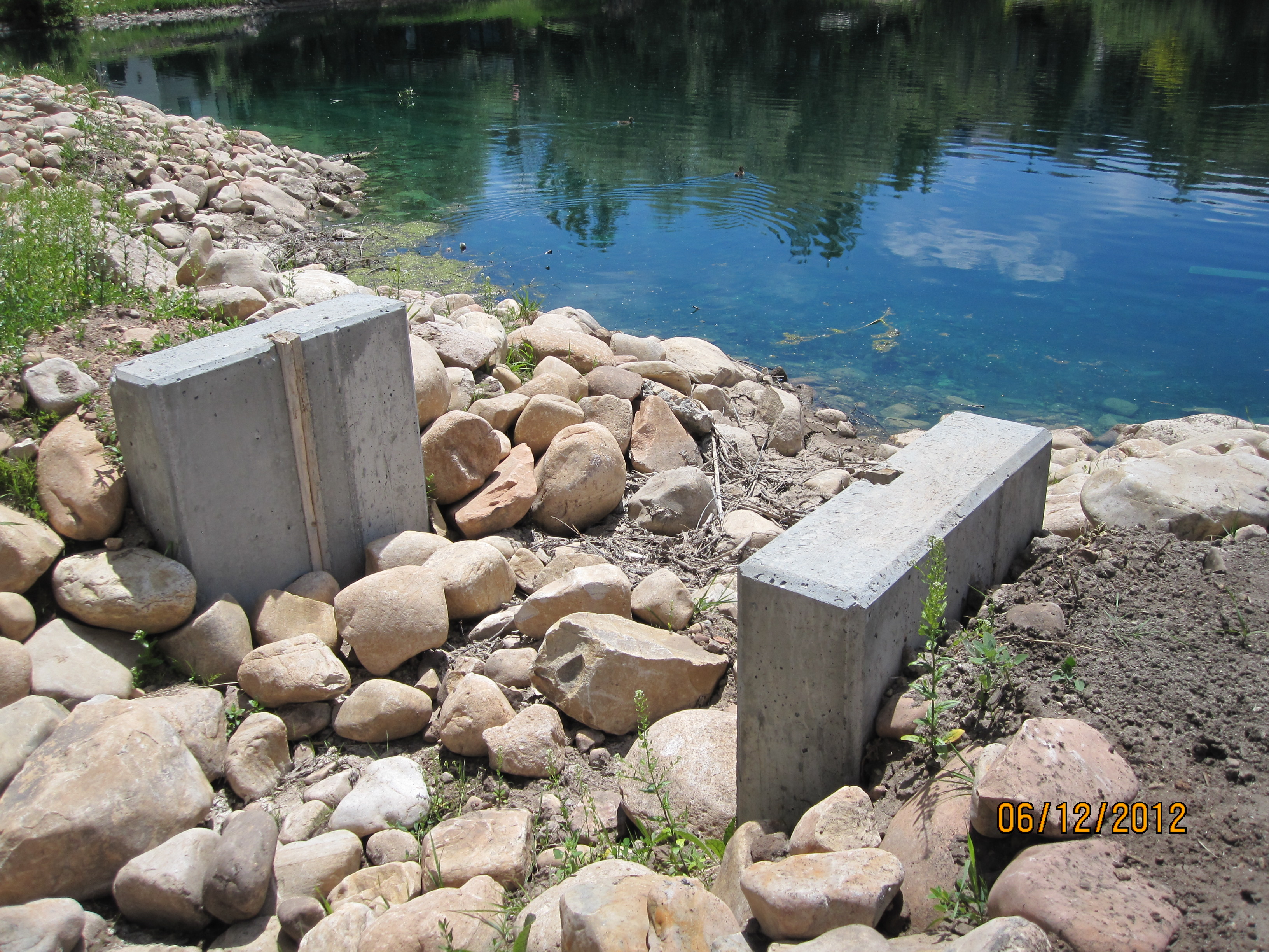 2012 Small lake gate built too high to allow water flow to Parcel V.